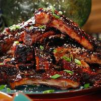 Asian Spice Rubbed Ribs with Pineapple-Ginger BBQ Sauce and Black and White Sesame Seeds Recipe
