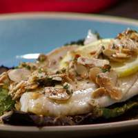 Branzino with Brown Butter and Almonds on a Bed of Crispy Kale Recipe