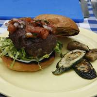 Cheese and Onion-Stuffed Burger with Grilled Tomato Chutney and Marinated Vegetables Recipe