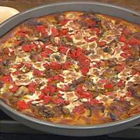 Chicago-Style Pan Pizza with Sausage, Mushrooms, Herbs and Tomatoes Recipe