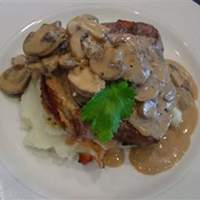 Crab-Stuffed Filet Mignon with Whiskey Peppercorn Sauce Recipe