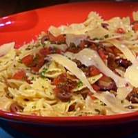 Farfalle with Fresh Tomatoes, Wine, Olives and Golden Raisins Recipe