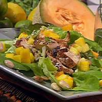 Marinated and Grilled Chicken Salad with Tropical Fruits, Marcona Almonds, Baby Lettuces and Lemon-Ginger Vinaigrette Recipe