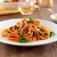 Thick Spaghetti with Marinara Sauce, Arugula and Parmigiano Cheese Recipe