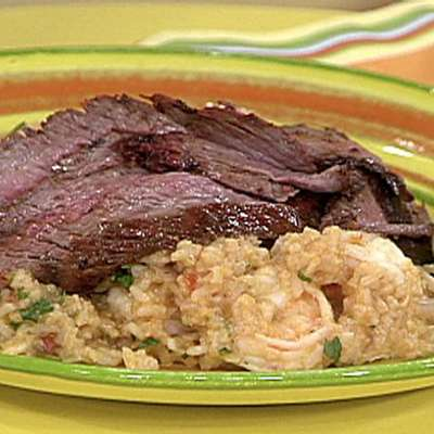 Sliced Chili Rubbed Flank Steak on Spicy Rice with Shrimp and Guacamole Stacks - RecipeNode.com